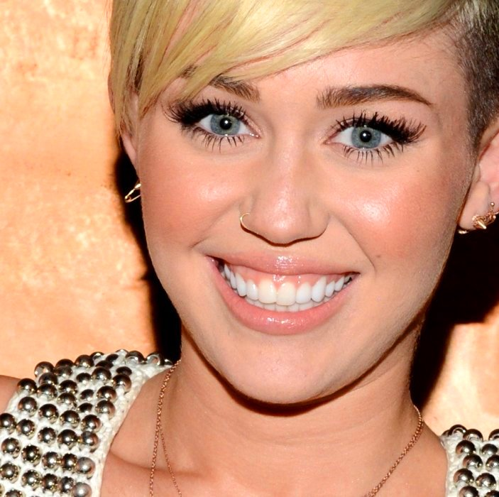 Pictured: Miley Cyrus pulling the slant-eye pose that